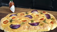 Easy Soda Focaccia with Red Onions, Olives, Cherry Tomatoes and Tabasco Oil - Allow to cool slightly before serving.