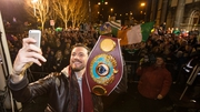 WBO champion Andy Lee takes a selfie with the belt in front of supporters outside Limerick City Hall tonight
