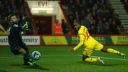 Liverpool's Raheem Sterling opens the scoring at Dean Court with a glancing header