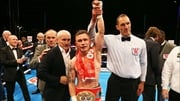 Carl Frampton celebrates winning his title with manager Barry McGuigan