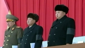Kim Jong-un (R) attends an event in Pyongyang, to mark the third anniversary of the death of his father
