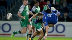 Leinster's Jamie Heaslip is tackled by Bundee Aki of Connacht
