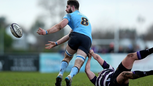 Shen Grannell of UCD passes after being tackled