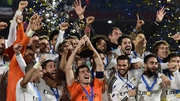 Real Madrid's players celebrate with the trophy after winning the FIFA Club World Cup