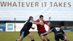 Munster's Denis Hurley is tackled by Warriors' Gordon Reid and Fraser Brown