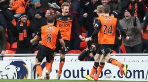 Dundee Utd's Stuart Armstrong (2nd L) celebrates scoring at Tannadice Park