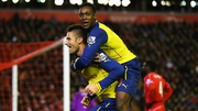 Olivier Giroud celebrates scoring Arsenal's second goal with Danny Welbeck