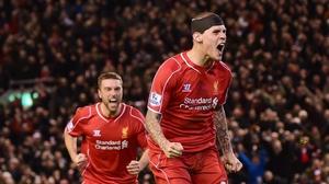 Liverpool defender Martin Skrtel (R) celebrates after scoring his late equaliser