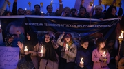 Pakistani lawyers and civil society activists hold lighted candles during a vigil in Islamabad
