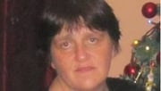 Elaine McCann is described as being 1.73m (5ft 8in) in height and weighing 69kg with short dark hair