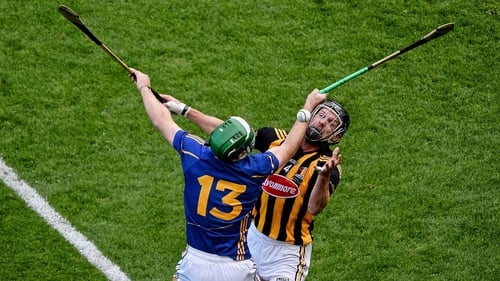 Tipperary's Noel McGrath and Kilkenny's Jackie Tyrell battle for possession in the drawn final