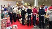 Volunteers help to prepare the meal