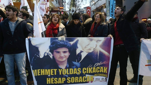 Protesters call for the release of 16-year-old Mehmet Emin Altunses, who was arrested on charges of insulting Mr Erdogan