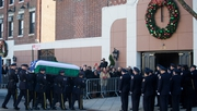 The casket of New York City police officer Rafael Ramos is carried into Christ Tabernacle Church prior to his wake