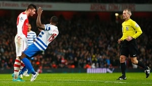 Olivier Giroud of Arsenal head butts Nedum Onuoha of QPR before being sent off by referee Martin Atkinson