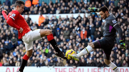Robin van Persie of Manchester United has his attempt on goal saved by Spurs goalkeeper Hugo Lloris