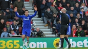 Chelsea's Cesc Fabregas earns a yellow card from referee Anthony Taylor rather than a penalty