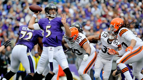 Quarterback Joe Flacco of the Baltimore Ravens drops back to pass in the first quarter of the game against the Cleveland Browns