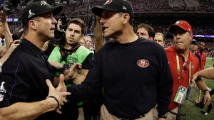 Jim Harbaugh (C) pictured with his brother John (L) after the San Francisco 49ers lost Super Bowl XLVII
