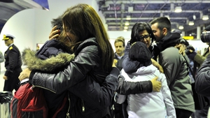 Survivors and relatives are reunited after arriving at the port of Igoumenitsa in northern Greece