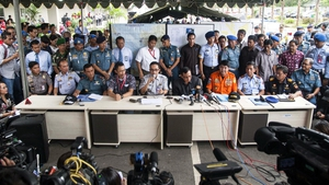 New details about the search for the missing plane are released at a press conference at Juanda Airport in Surabaya