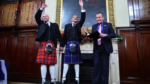 Joe Schofield (blue kilt) and Malcolm Brown from Tullibody, Clackmannanshire were married in the Trades house shortly after midnight