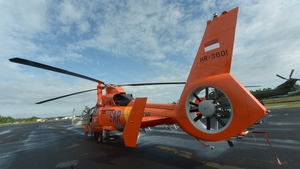 An Indonesian crew maintains a helicopter being used in the search for AirAsia flight QZ8501