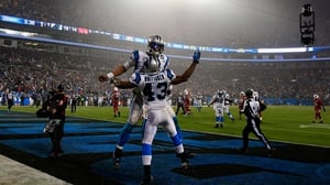 Cam Newton and Fozzy Whittaker celebrate a touchdown