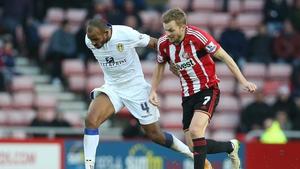 Leeds' Rudolph Austin (L) vies with Sunderland's Sebastian Larsson