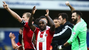 Jamal Campbell-Ryce of Sheffield United (C) celebrates victory with his team-mates