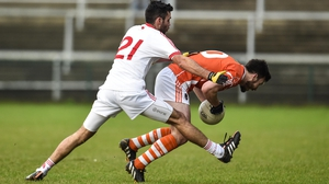 Tyrone's Emmet McKenna and Armagh's Stefan Forker compete for the ball