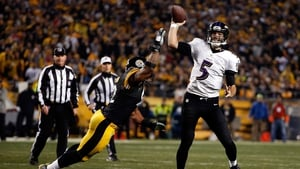 Joe Flacco of the Baltimore Ravens throws under pressure from the Pittsburgh Steelers' James Harrison