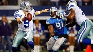 Tony Romo of the Dallas Cowboys is closed down by Ezekiel Ansah of the Detroit Lions