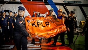 Indonesia Sea and Coast Guard carry seats recovered from AirAsia flight QZ8501
