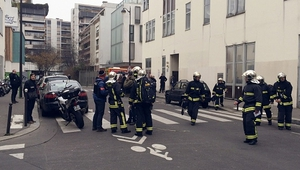 Police officers and firefighters gather at the scene