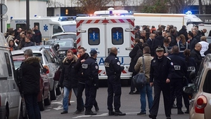 Ambulances and police officers gather at the scene of the attack