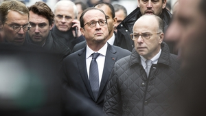 French President Francois Hollande and Interior Minister Bernard Cazeneuve arrive at the scene of the shooting in Paris