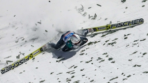 Simon Ammann suffers a high-speed fall in Bischofhofen