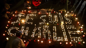 Candles are lit in Paris in memory of the 12 victims