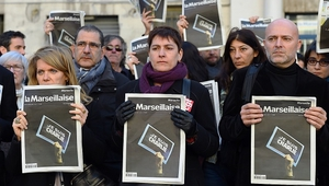 """French journalists of the regional newspaper """"La Marseillaise"""" gather to pay tribute to the people who lost their lives"""