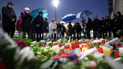 Mourners pay their respects to the victims of the attack on French magazine Charlie Hebdo outside the French Embassy, Berlin, Germany