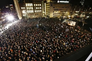 People in Rotterdam gather to pay their respects to the victims at 1940 Square, Rotterdam, Netherlands