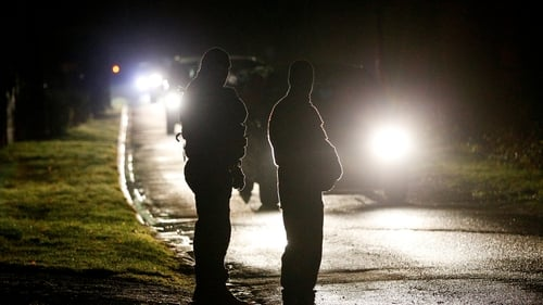 French police stand at a check point during the manhunt near Villers Cotterets, northeast of Paris