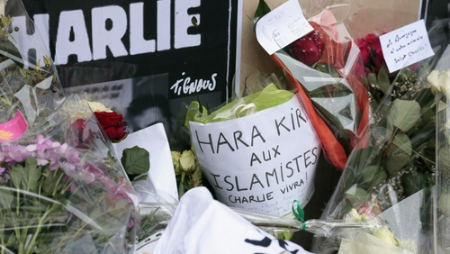 Tributes to the 12 victims of Wednesday's attack in Paris
