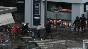 Police evacuate people from businesses close to the kosher store