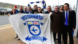 Cardiff City fans pose with chairman Mehmet Dalman and chief executive Ken Choo after it was announced that the club would revert to their blue home kit