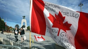 A commemorative flag near the War Memorial in Ottawa where a ceremonial guard was shot and killed by a gunman in October