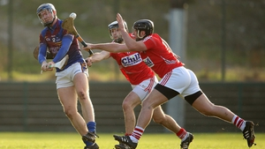 Cork's Glen O'Connor (L) and Alan Frahill-O'Connor put pressure on UL's Jason Forde