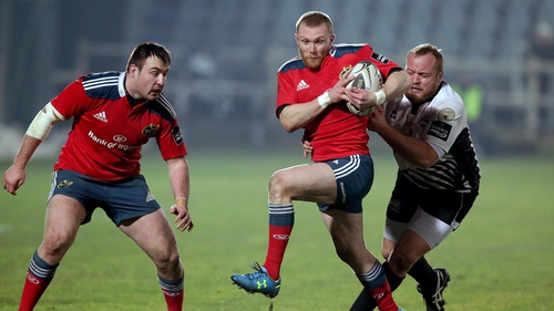Munster's Keith Earls tackled by Dario Chistolini of Zebre