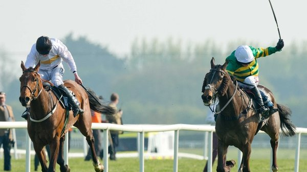 Barry Geraghty on Shutthefrontdoor (r) holds off Roger Loughran on Golden Wonder to win the 2014 Irish Grand National
